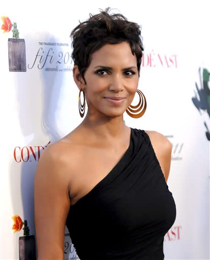 Actress Halle Berry is reported to be engaged to Olivier Martinez. In this picture, Actress Halle Berry attends The Fragrance Foundation's 2011 FiFi Awards at The Tent at Lincoln Center on Wednesday, May 25, 2011 in New York. (AP Photo/Evan Agostini)