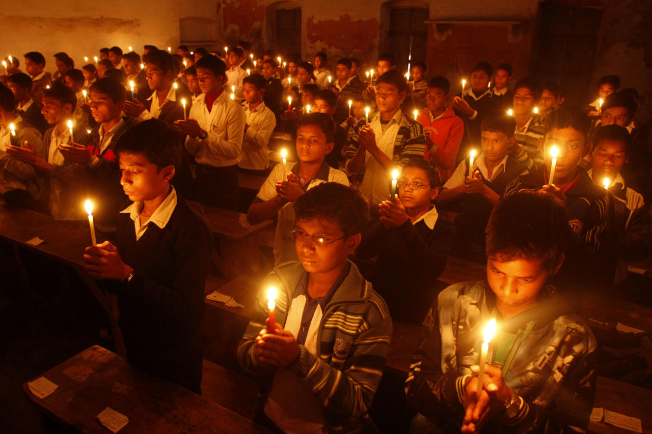 Indian students light candles to pay tribute to legendary Indian sitar player Ravi Shankar at the Bengali Tola Inter College where Shankar had studied in Varanasi,  India, Wednesday, Dec. 12, 2012. Shankar, who is credited with connecting the world to Indian music, died Tuesday in San Diego at the age of 92. (AP Photo/Rajesh Kumar Singh)