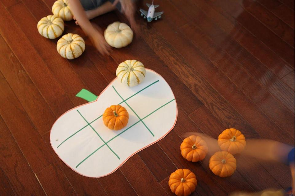 """<p>Play a fall-inspired game with pumpkins! With just a few materials needed, see who will be the tic-tac-toe champion on Thanksgiving.</p><p><a href=""""https://toddlerapproved.com/2015/09/pumpkin-tic-tac-toe-for-kids.html"""" rel=""""nofollow noopener"""" target=""""_blank"""" data-ylk=""""slk:Get the tutorial at Toddler Approved »"""" class=""""link rapid-noclick-resp""""><em>Get the tutorial at Toddler Approved »</em></a></p>"""