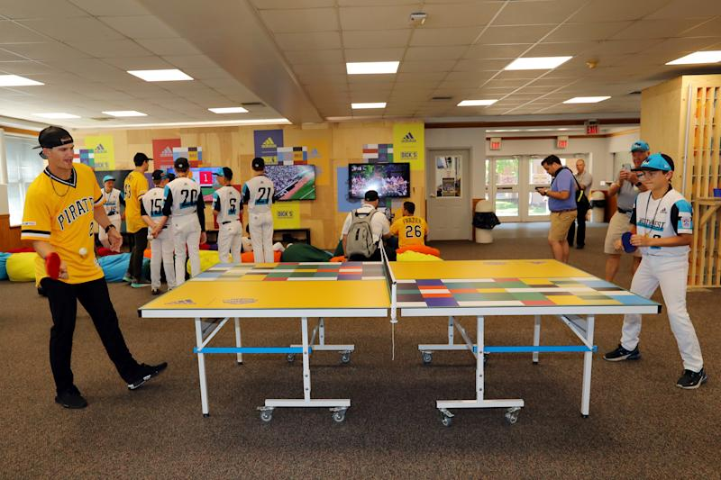 Kevin Newman of the Pittsburgh Pirates plays ping pong with Andrew Mhoon of the Northwest team in the game room at the Grove at the Little League complex prior to the 2019 Little League Classic between the Chicago Cubs and the Pittsburgh Pirates.