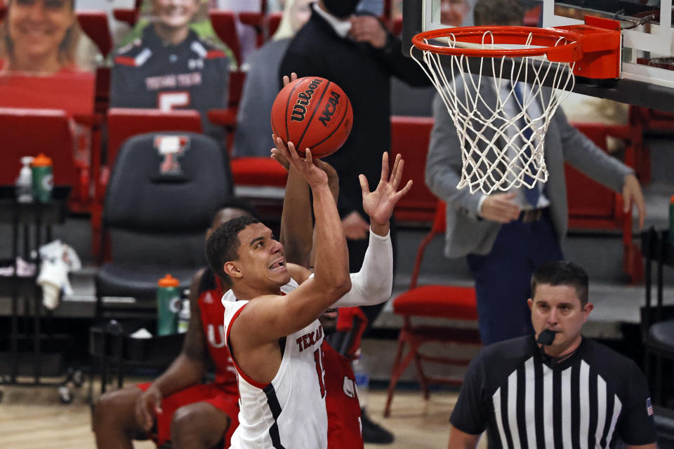 Texas Tech's Kevin McCullar (15) shoots during the first half of the team's NCAA college basketball game against Incarnate Word, Tuesday, Dec. 29, 2020, in Lubbock, Texas. (AP Photo/Brad Tollefson)