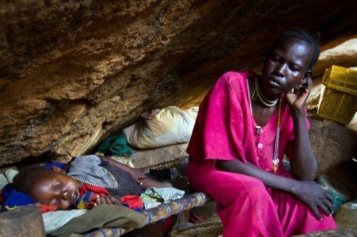 A mother rests with her child in a cave outside of Tess, South Kordofan, Sudan, in April 2012. Sudan pledged on Thursday to cease hostilities with South Sudan in accordance with a UN Security Council resolution, hours after the South alleged fresh Sudanese bombing of its border region