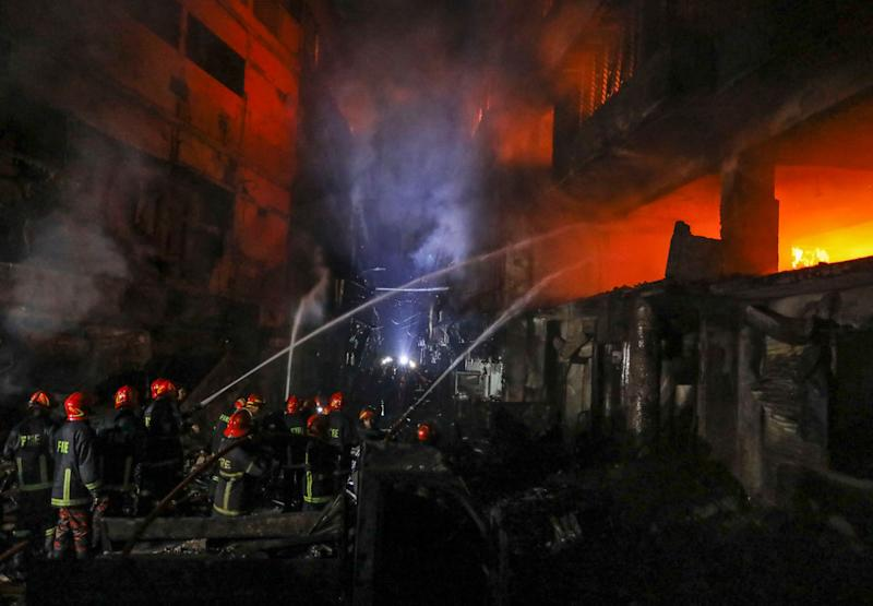 Firefighters work to douse flames in Dhaka, Bangladesh, Feb. 21, 2019. A devastating fire raced through at least five buildings in an old part of Bangladesh's capital and killed scores of people. (Photo:Zabed Hasnain Chowdhury/AP)