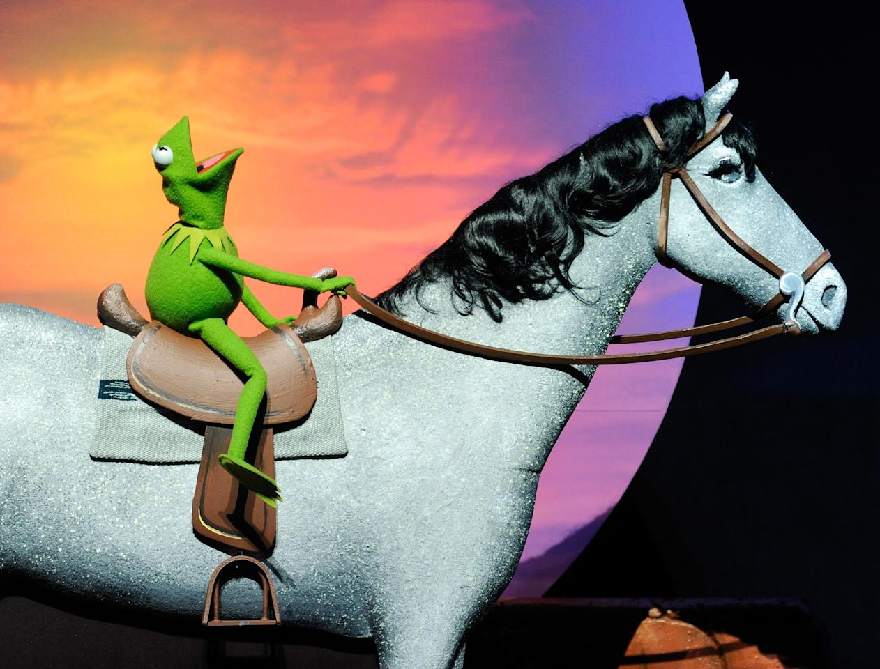 """LAS VEGAS, NV - APRIL 24:  A Kermit the Frog character appears on stage during an announcement that there will be a """"Muppets 2"""" movie at a Walt Disney Studios Motion Pictures presentation at The Colosseum at Caesars Palace during CinemaCon, the official convention of the National Association of Theatre Owners, April 24, 2012 in Las Vegas, Nevada.  (Photo by Ethan Miller/Getty Images)"""