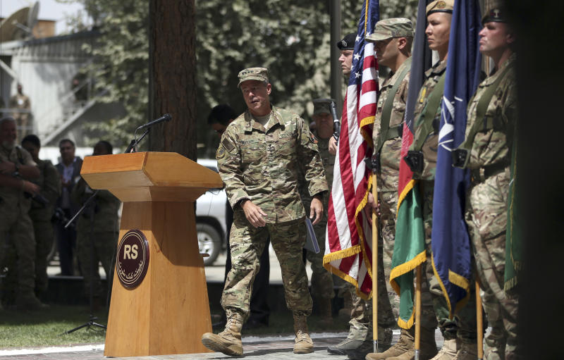 U.S. Army Gen. Austin Miller walks back to his chair after his speech during the change of command ceremony at Resolute Support headquarters in Kabul, Afghanistan, Sunday, Sept. 2, 2018. Miller assumed command of the 41-nation NATO mission in Afghanistan following a handover ceremony. (AP Photo/Massoud Hossaini)