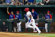 Texas Rangers' Andy Ibáñez runs to first base after hitting a home run during the first inning of a baseball game against the Oakland Athletics, Monday, June 21, 2021, in Arlington, Texas. (AP Photo/Sam Hodde)