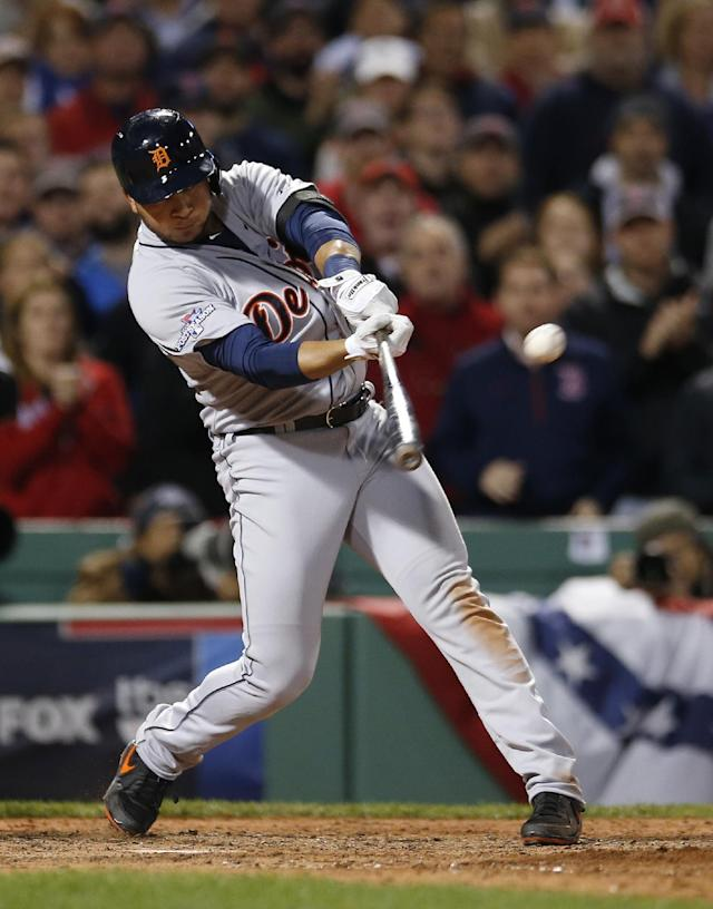 Detroit Tigers' Jhonny Peralta hits a single off Boston Red Sox starting pitcher Jon Lester to drive in a run in the sixth inning during Game 1 of the American League baseball championship series Saturday, Oct. 12, 2013, in Boston. (AP Photo/Elise Amendola)