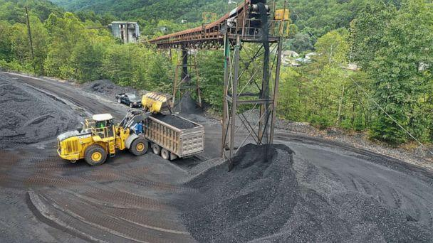 PHOTO: In this August 26, 2019, file photo, coal is loaded onto a truck at a mine on near Cumberland, Kentucky. (Scott Olson/Getty Images, FILE)