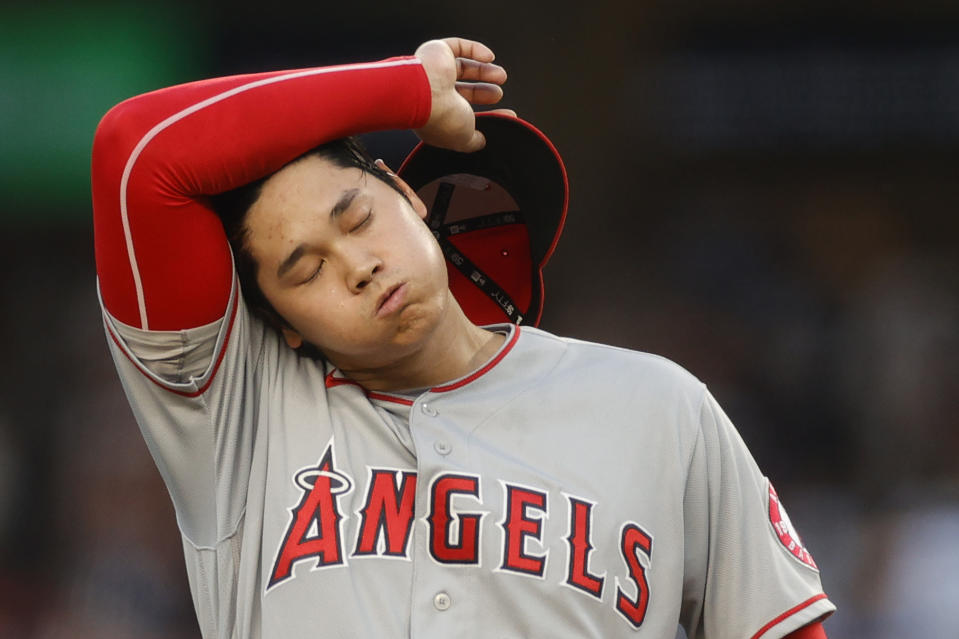 NEW YORK, NEW YORK - JUNE 30: Shohei Ohtani #17 of the Los Angeles Angels reacts after walking Brett Gardner #11 of the New York Yankees (not pictured) and allowing a run during the first inning at Yankee Stadium on June 30, 2021 in the Bronx borough of New York City. (Photo by Sarah Stier/Getty Images)