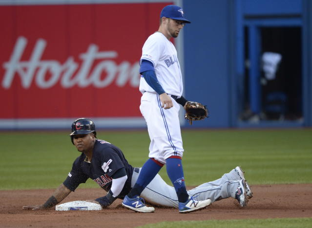 Cleveland Indians third baseman Jose Ramirez (11) steals second as Toronto Blue Jays second baseman Eric Sogard (5) looks on during the second inning of a baseball game, Wednesday, July 24, 2019 in Toronto. (Nathan Denette/Canadian Press via AP)