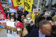 People chant slogans against government's decision to start releasing massive amounts of treated radioactive water from the wrecked Fukushima nuclear plant into the sea, during a rally outside the prime minister's office in Tokyo Tuesday, April 13, 2021. The decision, long speculated but delayed for years due to safety concerns and protests, came at a meeting of Cabinet ministers who endorsed the ocean release as the best option. (AP Photo/Eugene Hoshiko)