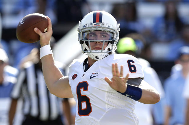 Virginia and quarterback Kurt Benkert (6) are off to a 5-1 start this year. (AP Photo/Gerry Broome)