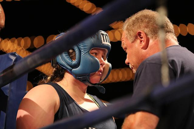 <p>Katie Walsh gets instructions from corner man before fight during the NYPD Boxing Championships at the Theater at Madison Square Garden on June 8, 2017. (Photo: Gordon Donovan/Yahoo News) </p>
