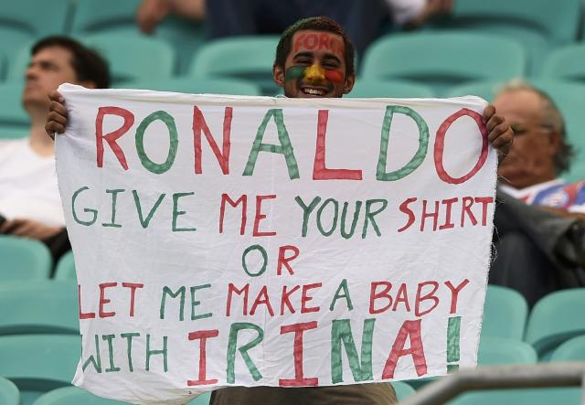 A Portugal fan holds up a banner addresssed to Portugal's Cristiano Ronaldo as he waits for the start of the 2014 World Cup Group G soccer match between Germany and Portugal at the Fonte Nova arena in Salvador, June 16, 2014. REUTERS/Dylan Martinez (BRAZIL - Tags: SOCCER SPORT WORLD CUP)