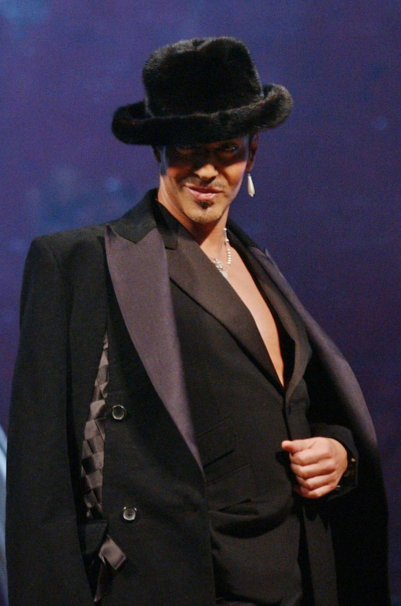 FILE - In this July 2, 2004 file photo, British fashion designer John Galliano appears after the presentation of his Spring/Summer 2005 men's fashion show, in Paris. Israel's national broadcast authority has banned the country's contestant in the upcoming Eurovision contest from wearing a dress made by John Galliano, citing an anti-semitic rant by the celebrity designer two years ago. There's only one problem: Galliano says he never offered to make the dress. (AP Photo/Jacques Brinon)