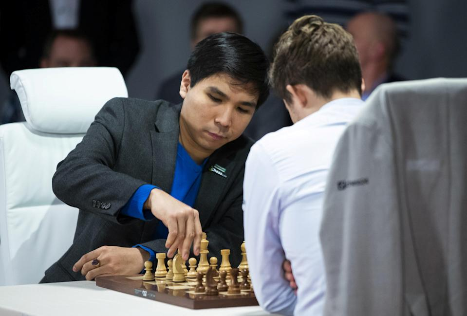 FILE PHOTO: Norway's Magnus Carlsen and Wesley So of the US play final games during the World Fischer Random Chess Championship 2019 at Henie Onstad Art Center in Baerum, Norway, October 31, 2019. NTB Scanpix/Berit Roald via REUTERS