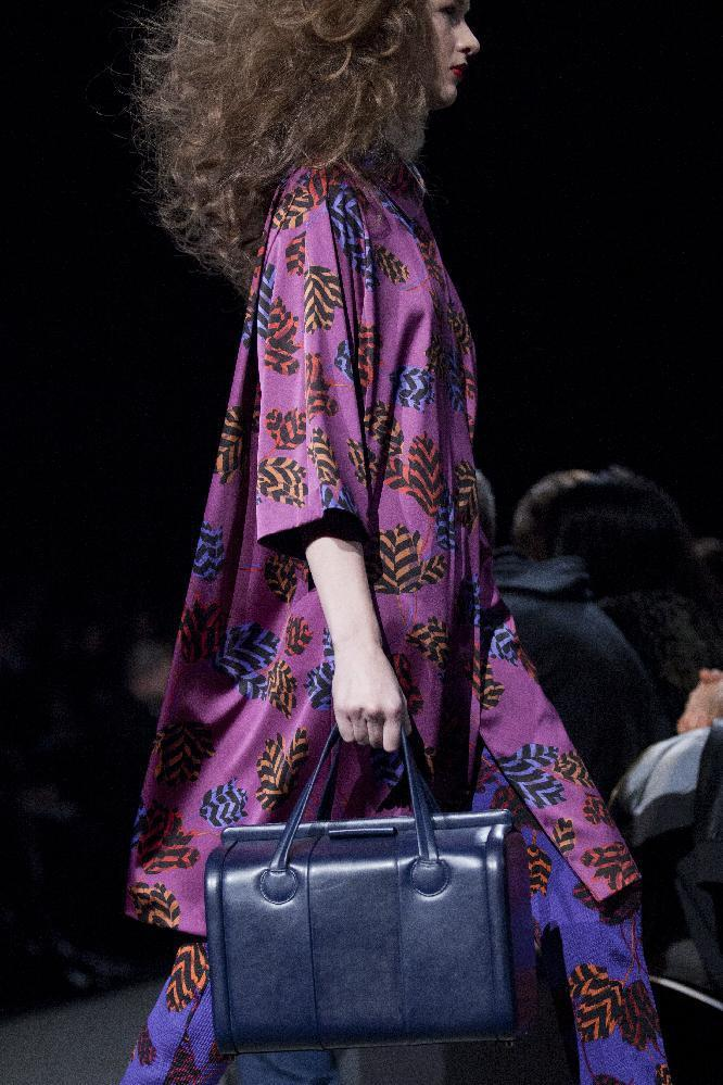 FILE - In this Feb. 11, 2013 file photo, a model walks the runway during the Marc by Marc Jacobs Fall 2013 fashion show during Fashion Week, in New York. Orchid is growing on us: A version of the purple hue is Pantone Inc.'s color of the year for 2014. (AP Photo/Karly Domb Sadof, File)