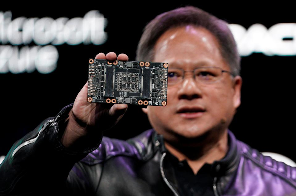 Jensen Huang, CEO of Nvidia, shows the NVIDIA Volta GPU computing platform at his keynote address at CES in Las Vegas, Nevada, U.S. January 7, 2018. REUTERS/Rick Wilking
