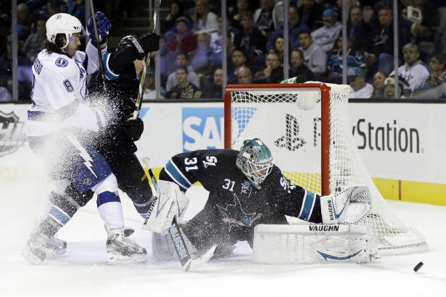 San Jose Sharks goalie Antti Niemi, of Finland, right, stops a shot on goal next to Tampa Bay Lightning's Mark Barberio (8) during the second period of an NHL hockey game on Thursday, Nov. 21, 2013, in San Jose, Calif. (AP Photo/Marcio Jose Sanchez)
