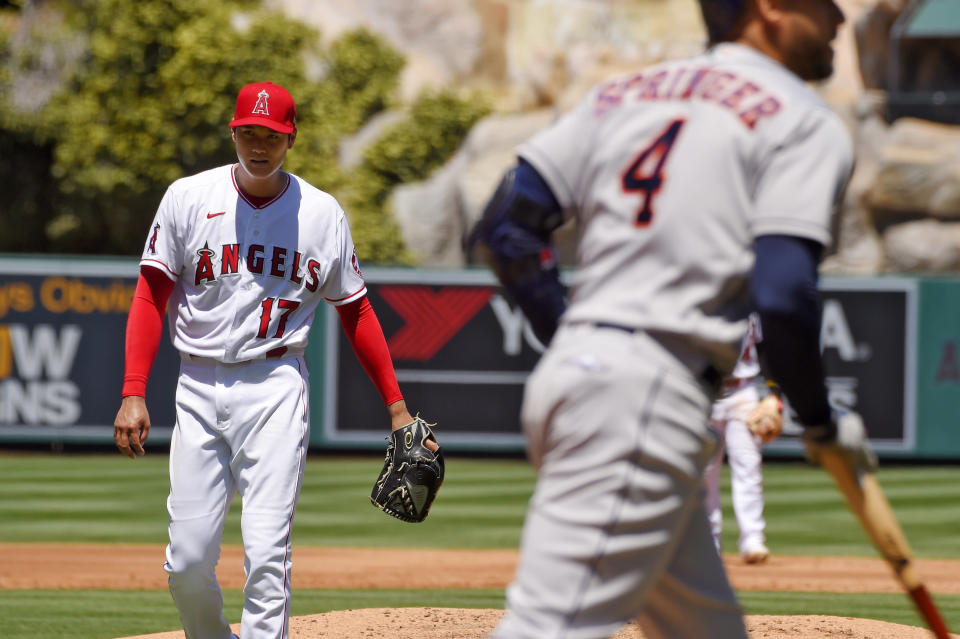 Los Angeles Angels pitcher Shohei Ohtani, of Japan, stands at left after walking Houston Astros' George Springer with the bases loaded during the second inning of a baseball game Sunday, Aug. 2, 2020, in Anaheim, Calif. (AP Photo/Mark J. Terrill)