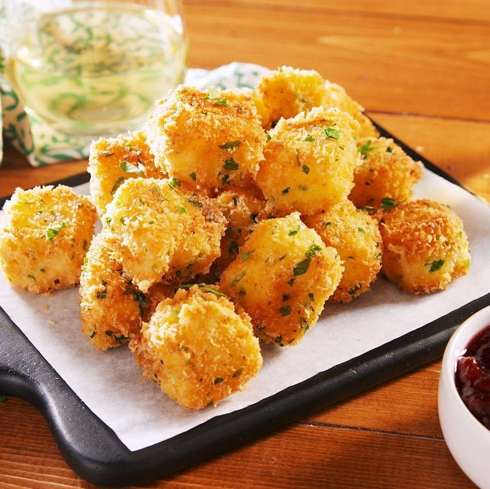 """<p>Don't get us wrong—we love baked <a href=""""https://www.delish.com/uk/cooking/recipes/a31219765/bloomin-brie-bread-recipe/"""" rel=""""nofollow noopener"""" target=""""_blank"""" data-ylk=""""slk:brie"""" class=""""link rapid-noclick-resp"""">brie</a>. But it's not the most exciting party app. Fried brie, on the other hand, is absolutely INSANE. This recipe is super easy, but you will need to plan ahead. The brie needs to freeze for a good hour, otherwise, it'll melt like cray in the hot oil.</p><p>Get the <a href=""""https://www.delish.com/uk/cooking/recipes/a31277445/fried-brie-bites-recipe/"""" rel=""""nofollow noopener"""" target=""""_blank"""" data-ylk=""""slk:Frie Brie Bites"""" class=""""link rapid-noclick-resp"""">Frie Brie Bites</a> recipe.</p>"""