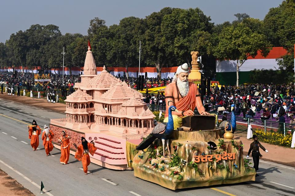 Performers dance next to a float representing Uttar Pradesh state on Rajpath during the Republic Day parade in New Delhi on January 26, 2021. (Photo by Jewel SAMAD / AFP) (Photo by JEWEL SAMAD/AFP via Getty Images)