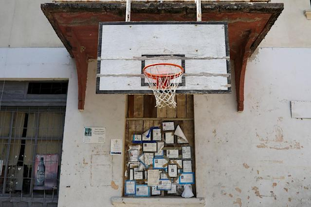 <p>Death notices are seen on a wall below a basketball board in the village of Strbac, near the southeastern town of Knjazevac, Serbia, Aug. 15, 2017. (Photo: Marko Djurica/Reuters) </p>