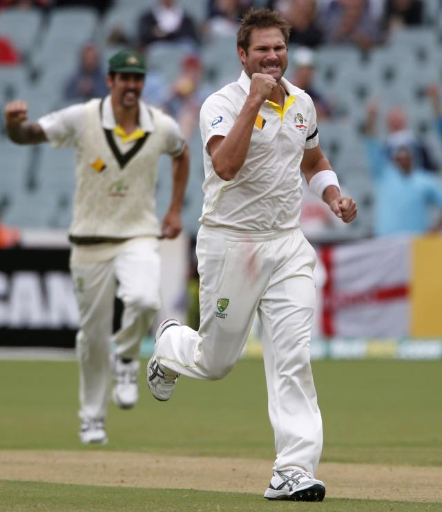 Australia's Ryan Harris (R) celebrates after taking the wicket of England's Graeme Swann (not pictured) during the fifth day's play in the second Ashes cricket test at the Adelaide Oval December 9, 2013. REUTERS/David Gray (AUSTRALIA - Tags: SPORT CRICKET)