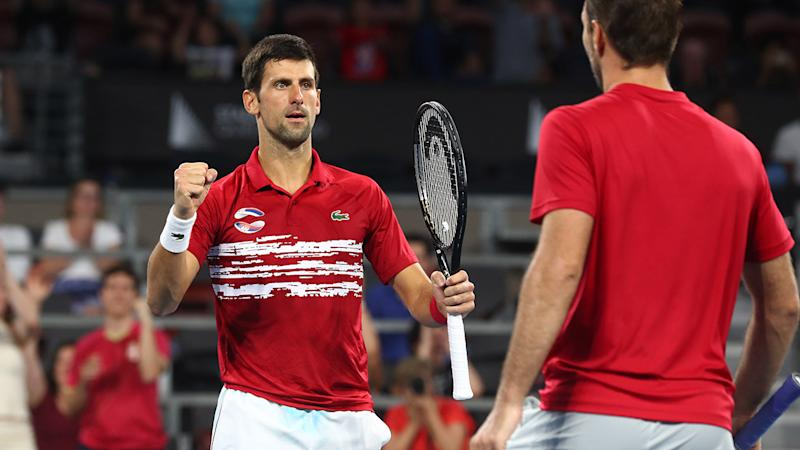 Novak Djokovic and Viktor Troicki, pictured here celebrating victory at the ATP Cup.
