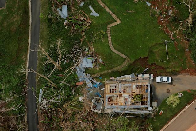<p>The contents of a damaged home can be seen as recovery efforts continue following Hurricane Maria near the town of Comerio, Puerto Rico, Oct. 7, 2017. (Photo: Lucas Jackson/Reuters) </p>