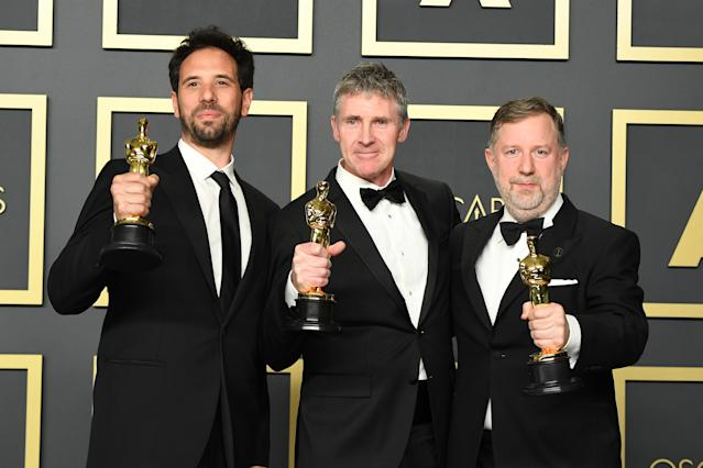 """Guillaume Rocheron, Dominic Tuohy and Greg Butler, winners of the Visual Effects award for """"1917,"""" pose in the press room during the 92nd Annual Academy Awards at Hollywood and Highland on February 09, 2020 in Hollywood, California. (Photo by Steve Granitz/WireImage )"""