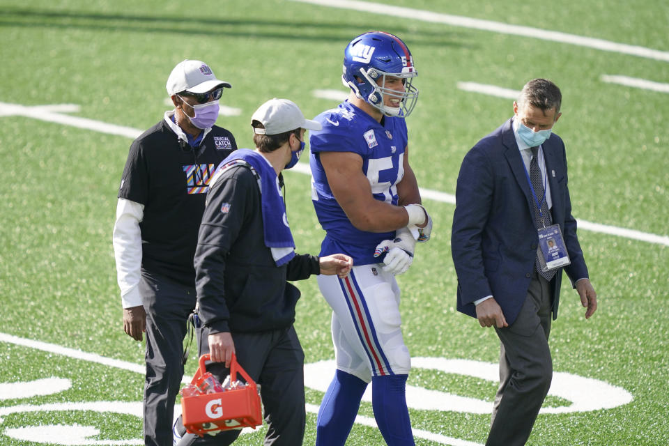 New York Giants inside linebacker Blake Martinez (54) reacts after being hurt during the second half of an NFL football game against the Washington Football Team, Sunday, Oct. 18, 2020, in East Rutherford, N.J. (AP Photo/John Minchillo)