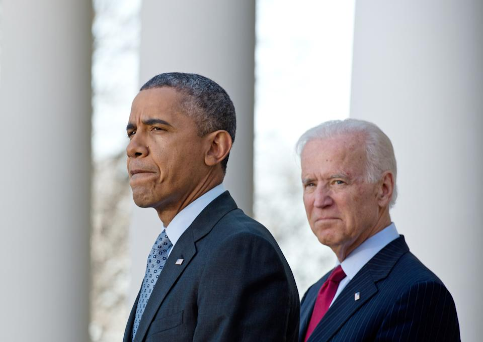 US President Barack Obama speaks about the Affordable Care Act, also known as Obamacare, with Vice President Joe Biden in the Rose Garden at the White House in Washington on April 1, 2014. Hundreds of thousands of Americans rushed to buy Obama's new health insurance plans on March 31, prompting a victory lap from a White House that paid a steep political price for its greatest achievement. The scramble to sign up under Obama's health care law at the end of a six-month enrollment window caused website glitches and long lines at on-the-spot enrollment centers.    AFP PHOTO/Nicholas KAMM        (Photo credit should read NICHOLAS KAMM/AFP via Getty Images)