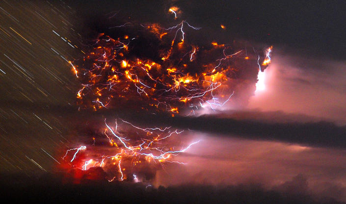 Volcanic lightning is seen over the Puyehue volcano, over 500 miles south of Santiago, Chile, Sunday June 5, 2011. Authorities have evacuated about 600 people in the nearby area. The volcano was calm on Sunday, one day after raining down ash and forcing thousands to flee, although the cloud of soot it had belched out still darkened skies as far away as Argentina. (AP Photo/Francisco Negroni, AgenciaUno)