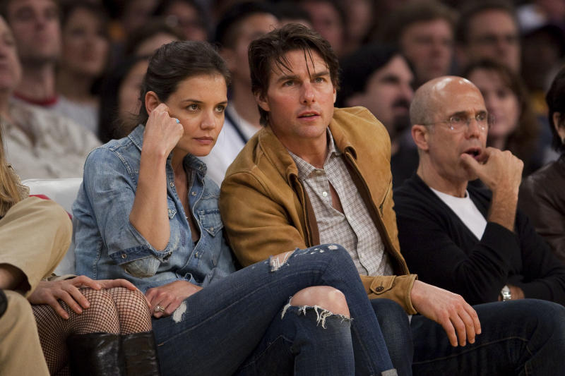 FILE - In this Friday, March 19, 2010 file photo, Katie Holmes and Tom Cruise watch the Minnesota Timberwolves play the Los Angeles Lakers in an NBA basketball game, in Los Angeles. The Lakers won 104-96. Holmes' attorney Jonathan Wolfe said Friday June 29, 2012 that the couple is divorcing, but called it a private matter for the family. (AP Photo/Jeff Lewis, File)