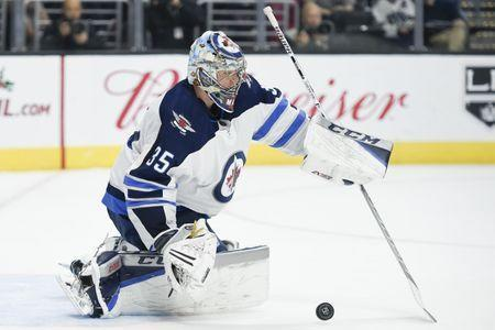 FILE PHOTO: Nov 22, 2017; Los Angeles, CA, USA; Winnipeg Jets goalie Steve Mason (35) makes a save against the Los Angeles Kings during the second period at Staples Center. Kelvin Kuo-USA TODAY Sports