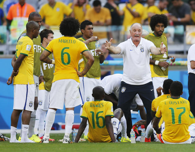 Brazil's coach Luiz Felipe Scolari gives instructions to his players before the extra time during the World Cup round of 16 soccer match between Brazil and Chile at the Mineirao Stadium in Belo Horizonte, Brazil, Saturday, June 28, 2014. (AP Photo/Frank Augstein)