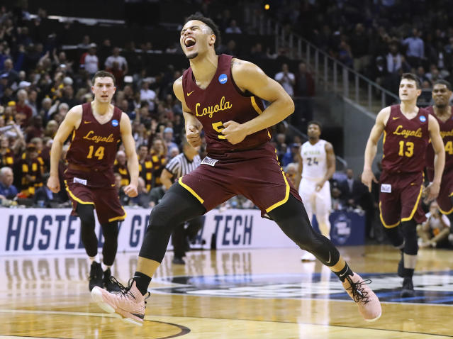 Loyola-Chicago guard Marques Townes reacts to hitting a 3-pointer in the final minute of the team's 69-68 victory over Nevada. (Curtis Compton/Atlanta Journal-Constitution via AP)