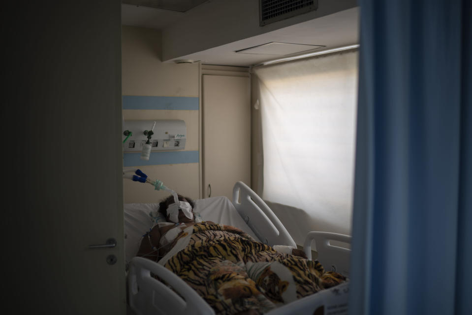 An intubated COVID-19 patient is treated in the ICU of the Sao Jose municipal hospital, in Duque de Caxias, Brazil, Wednesday, March 24, 2021. (AP Photo/Felipe Dana)