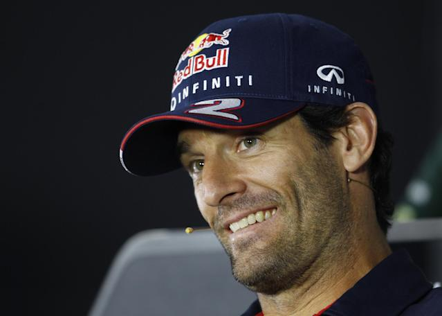 Red Bull driver Mark Webber of Australia smiles during the drivers press conference ahead of the Indian Formula One Grand Prix at the Buddh International Circuit in Noida, India, Thursday, Oct. 24, 2013. (AP Photo/Aijaz Rahi)