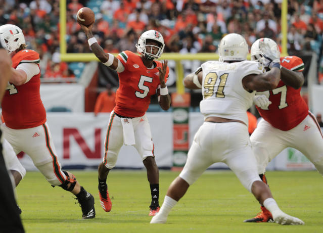 Miami quarterback N'Kosi Perry (5) passes during the first half of an NCAA college football game against FIU, Saturday, Sept. 22, 2018, in Miami Gardens, Fla. (AP Photo/Lynne Sladky)