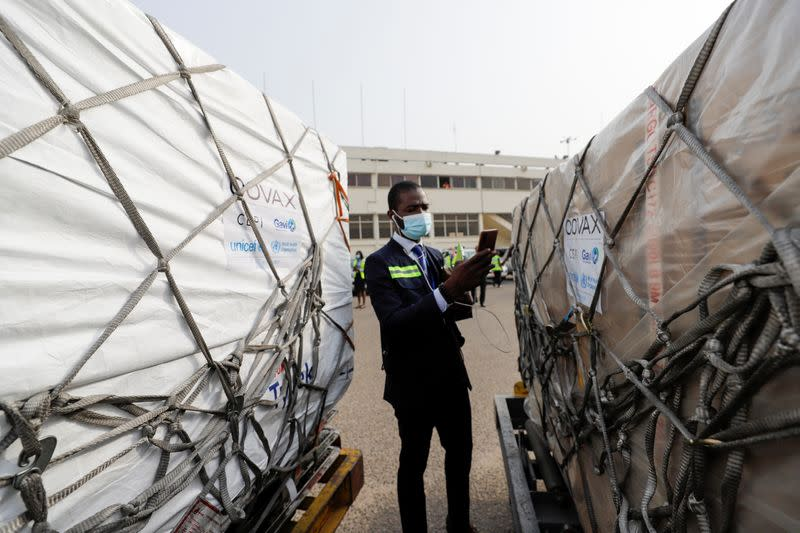 A worker checks boxes of AstraZeneca/Oxford vaccines as the country receives its first batch of coronavirus disease (COVID-19) vaccines under COVAX scheme, in Accra