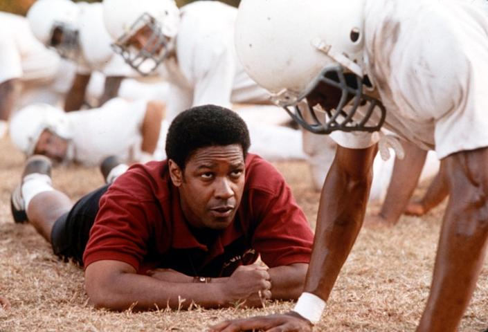 "Denzel Washington tackles the 2000 role of coach Herman Boone in ""Remember the Titans."" <span class=""copyright"">(Tracy Bennett / Buena Vista Pictures)</span>"