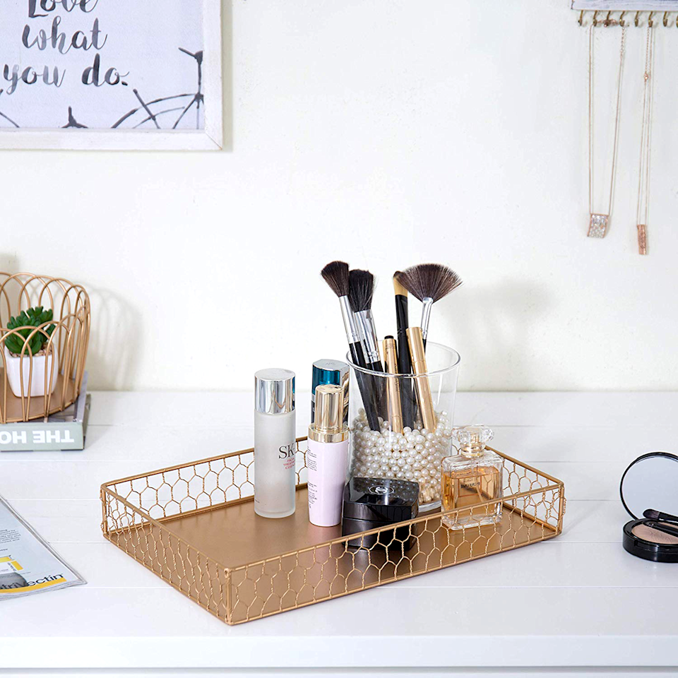 """<p>If you love makeup, then you probably also love organizing (and re-organizing) your stash. After all, you've spent years building your collection, and so you want to show it off effectively. Unfortunately, organizing makeup isn't always as easy as it sounds. If you've got a ton of products, you could wind up stacking them or storing them deep inside a drawer — which means you can't always find everything you need. </p><p>This weekend, tap into the joy of tidying up with these simple makeup organizer ideas that you can buy or DIY. These fun storage vessels — from cute cookie jars to rolling carts with shelves — will organize all of your <a href=""""https://www.goodhousekeeping.com/beauty-products/lipsticks/g25333316/best-long-lasting-lipsticks/"""" target=""""_blank"""">lipsticks</a>, <a href=""""https://www.goodhousekeeping.com/beauty/makeup/g4907/best-eyeshadow-palette/"""" target=""""_blank"""">eyeshadow palettes</a>, and <a href=""""https://www.goodhousekeeping.com/beauty-products/g28185044/best-perfume-for-women/"""" target=""""_blank"""">perfumes</a> in the most efficient and beautiful ways possible. Before you know it, your vanity will be neat as can be — and you'll be ready to add more of the <a href=""""https://www.goodhousekeeping.com/beauty/makeup/tips/g2329/best-drugstore-cosmetics/"""" target=""""_blank"""">best makeup products</a> to your collection. </p>"""