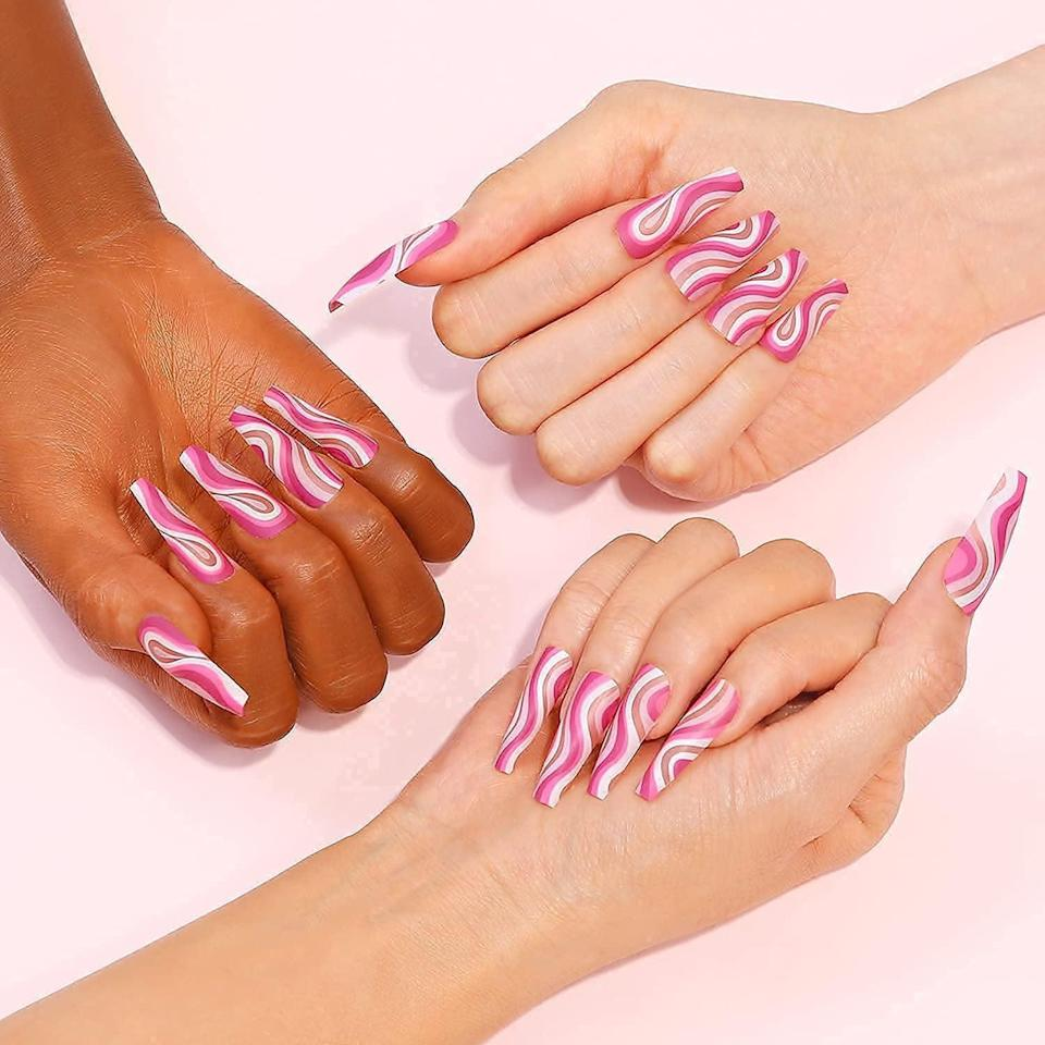 <p>Give yourself an ultra-trendy mani with this <span> Pink With White Design Ballerina Coffin Nail Set</span> ($7, originally $9). The long nail set is so stylish, it deserves a grid post on Instagram.</p>