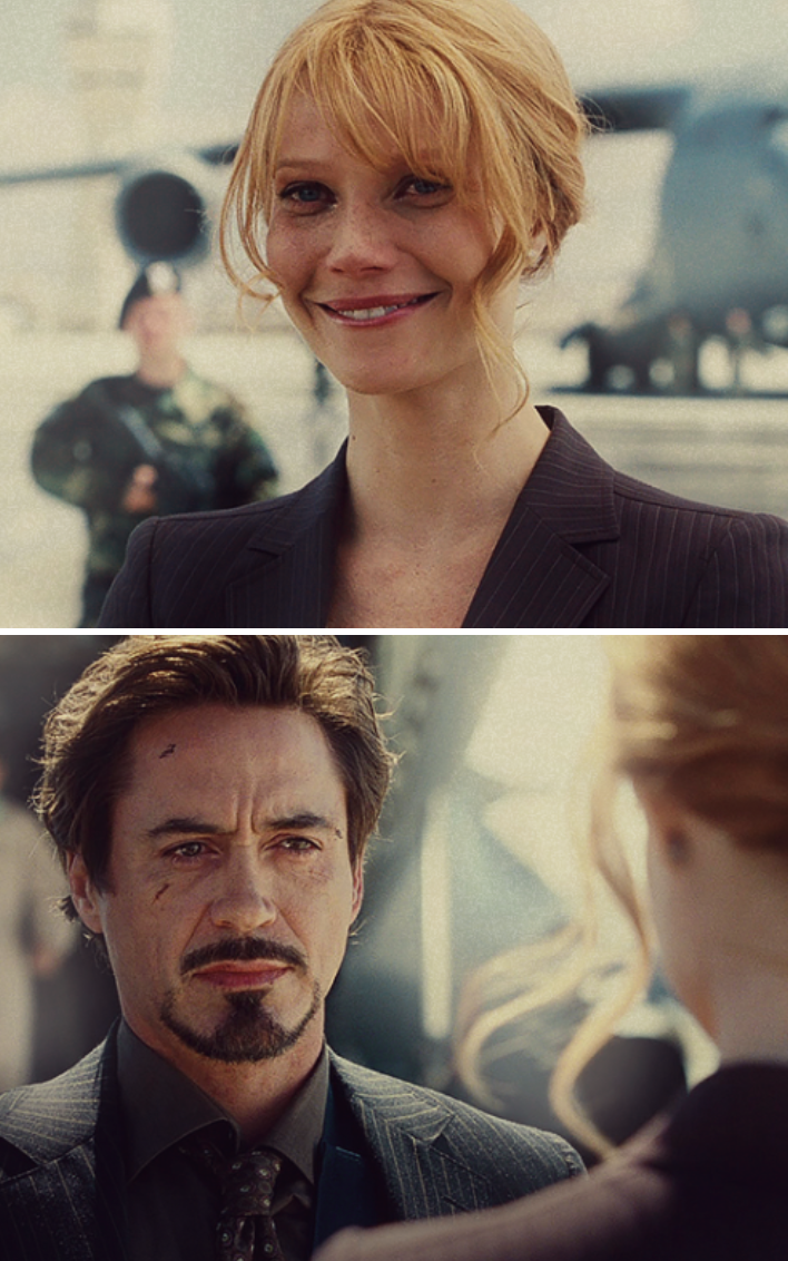 """Pepper and Tony looking at each other at the end of """"Iron Man"""" with battle scars on their faces"""