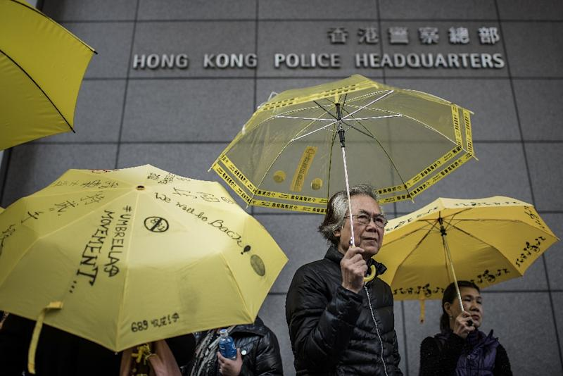 Supporters of the 2014 pro-democracy Umbrella Movement protests held yellow to defend themselves from police (AFP Photo/PHILIPPE LOPEZ)
