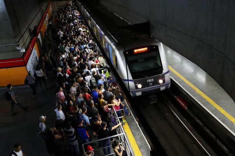 People gather at Se subway station amid the coronavirus disease (COVID-19) outbreak in Sao Paulo