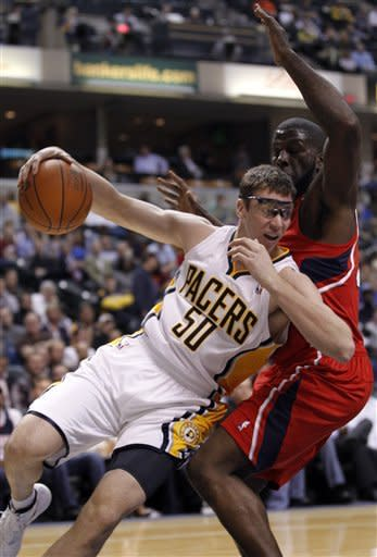 Indiana Pacers forward Tyler Hansbrough (50) is fouled by Atlanta Hawks forward Ivan Johnson in the second half of an NBA basketball game in Indianapolis, Wednesday, Jan. 11, 2012. The Pacers defeated the Hawks 96-84. (AP Photo/Michael Conroy)