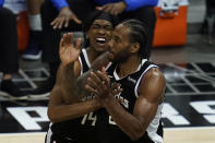 Los Angeles Clippers guard Terance Mann (14) and forward Kawhi Leonard (2) celebrate a shot during the fourth quarter of Game 7 of an NBA basketball first-round playoff series against the Dallas Mavericks Sunday, June 6, 2021, in Los Angeles, Calif. (AP Photo/Ashley Landis)